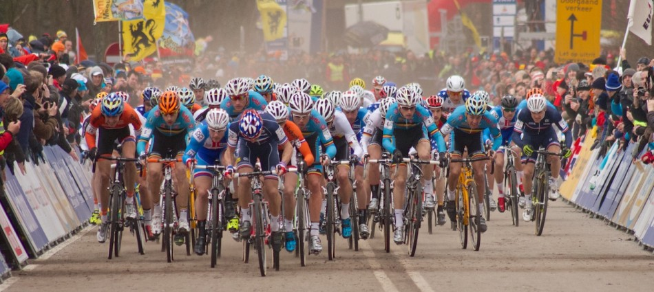 Clouds of dust billow behind the men as they sprint off the start line in Hoogerheide.
